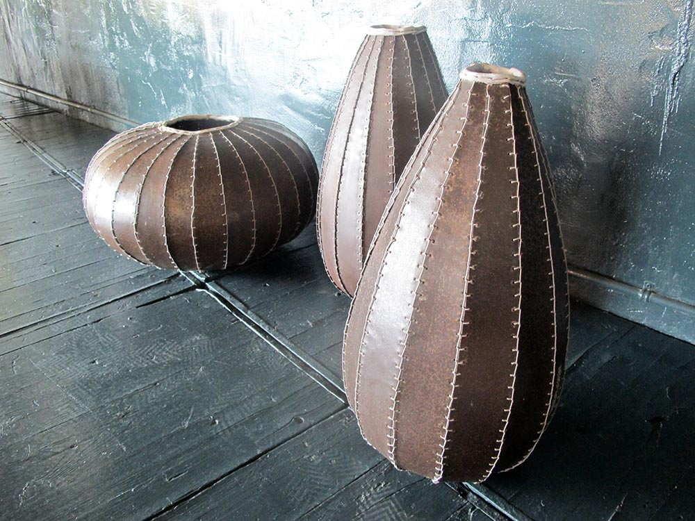 CLOVES vases ,hand made from iron and fishing net strings diam30x56cm h, diam 56x28 cm h.
