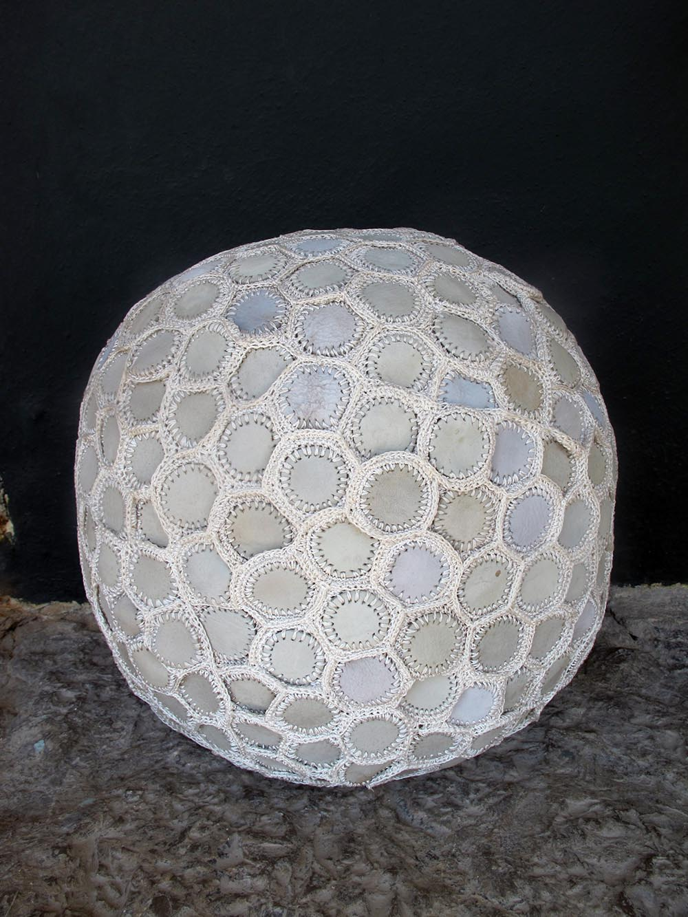 MAUINGO pouf,hand made with cow leather and fishing net string . diam 37 cm