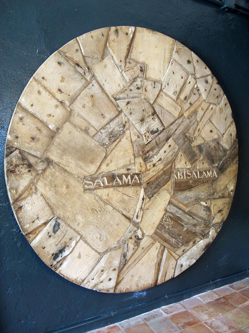 ROUND door or top table or just a decorative panell hand made in Kenya with old pics of wood from swahili canoos. Diameter 200x6cm deep