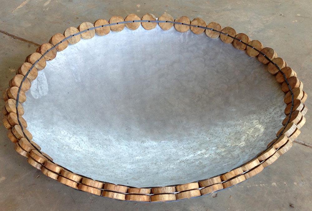 WOO hand made bowls with recicled aluminum ,mango wood and fishing net string. Diam 82 cm Diam 62 cm Diam 36 cm